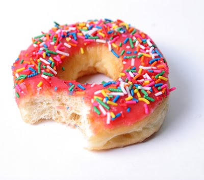 pink-glazed-donut-with-sprinkles